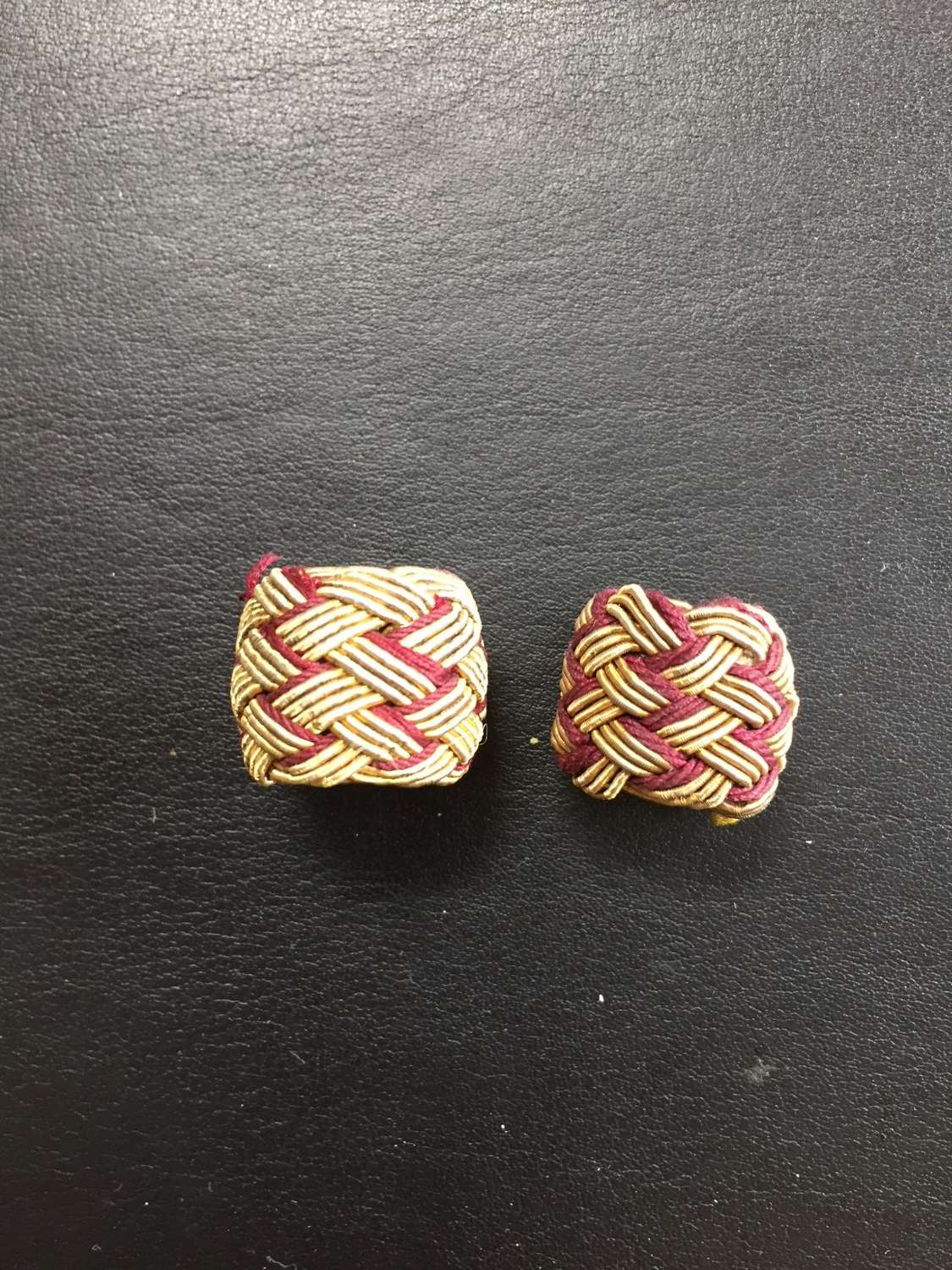 A pair of spare sliders for a full dress sword knot
